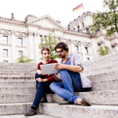 Students with Tablet PC on the steps of the Berlin Reichstag.